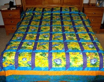 Quilt -- Attic Windows Pattern in Yellow Orange Purple and Blue Fish Fabric