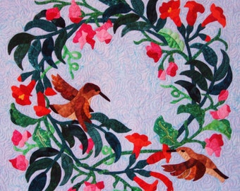 Quilted Wall Hanging - Snapdragon and Trumpet Flower Wreath with Hummingbirds in range, Pink, Green and Brown against Sky Blue