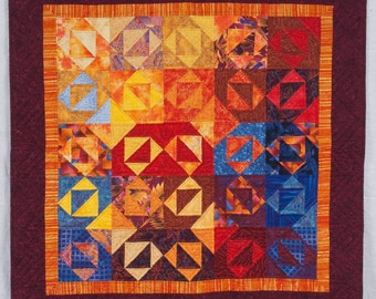 Quilted Wall  Hanging -- Red, Yellow, Orange and Blue Play to Create Shifting Images of Envelopes and Stars