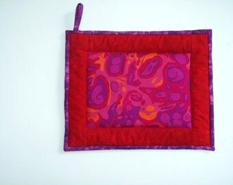 "Oversized Quilted Pot Holder / Hot Pad -- Red, Pink and Orange ""Amoeba"" Fabric with Red Borders"