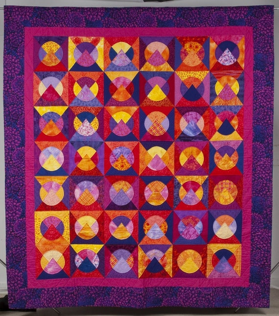 Quilt --  Circles within Diagonal Pieced Blocks in Red, Yellow, Orange, Pink and Purple