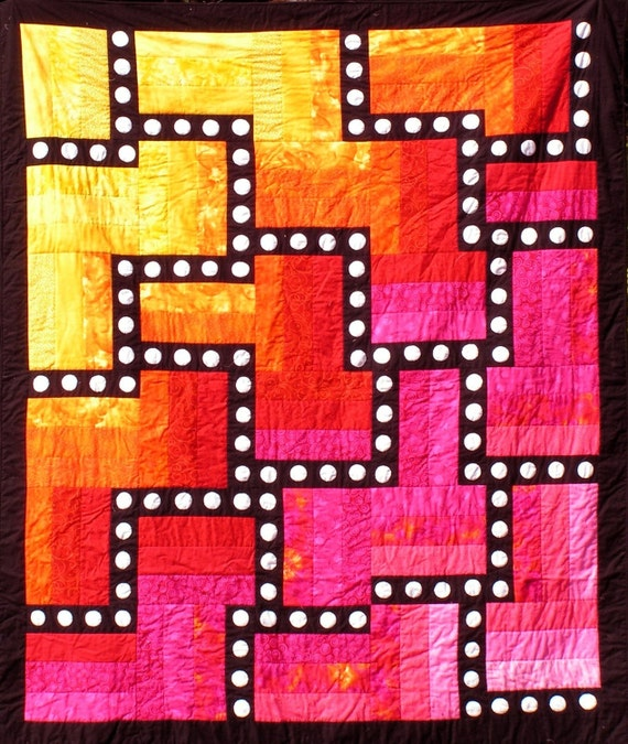 Quilt--Hot Colors of Yellow, Orange, Red and Pink Form the Background for a Black Maze with White Appliqued Circles