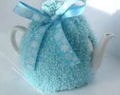 Tea Cosy in Pale Blue Sparkly Yarn with Snowflake Ribbon