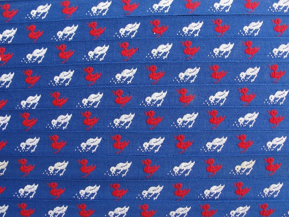 1 yard of Blue Cotton Trim with Red and White Birds. 0.5 inch width.