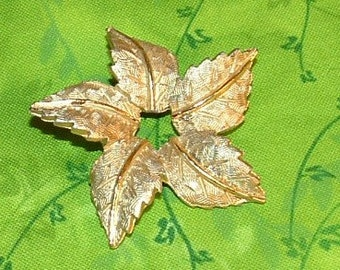 FIVE GOLD LEAVES BROOCH