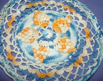 Blue Yellow and White Crocheted Doily