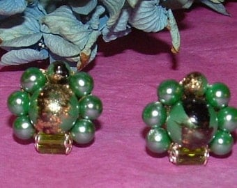 Clearance Sale.........Vintage Green Cluster Bead and Crystal clip earrings with black and gold enamel accent