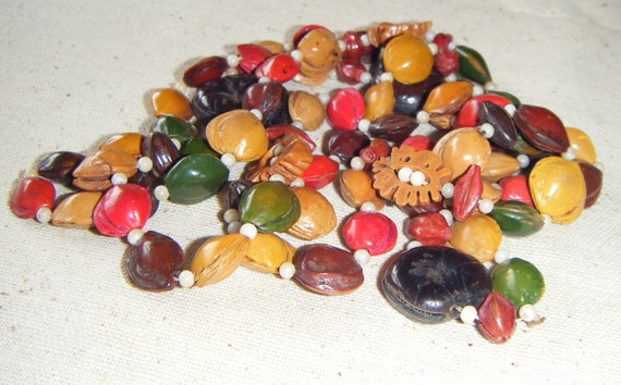 Beads - Painted Seeds, pods and nutshells (over 75)  single strand