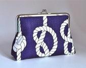 Medium sized purse with knots on navy blue