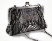 Art Deco styled clutch purse with photomontaged rock design and 8 inch frame with chain