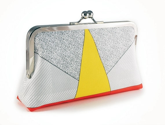 Clutch purse with yellow triangle
