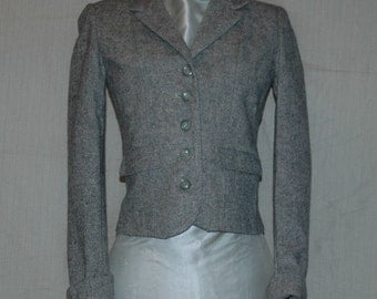 Light Gray Herringbone 100 Percent Virgin Wool Jacket. Button down, 2 front pockets,cuff sleeve. Overstock. S: 5/6. FREE DOMESTIC SHIPPING