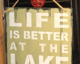 LIFE is Better at the LAKE Sign/Lake house