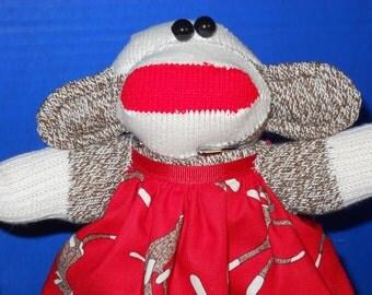 Sock Monkey baby with red sock monkey dress