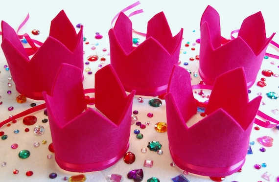 decorate your own felt crown kit-party pack of five crowns with adjustable ribbon ties comes with gemstones and felt pieces for decorating.  your choice of crown color(s)