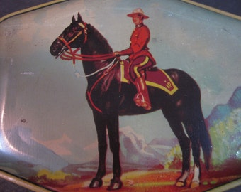 vintage horner toffee candy tin, canadian mountie lid