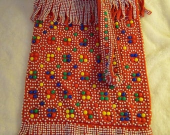 Colorful vintage fringed fabric shoulder bag red with blue, yellow, green and white bead-like attachments