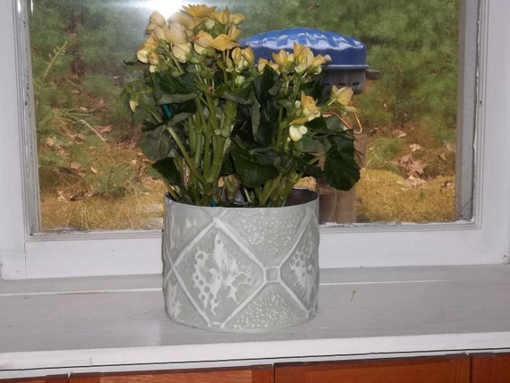 Nice Looking Grey plant holder in old ceiling tin.