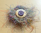 Hairy clock face brooch