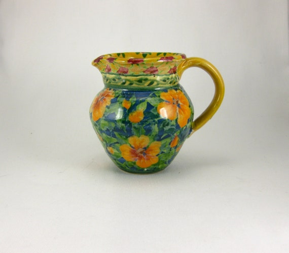 Blue porcelain handmade small pitcher with orange flowers