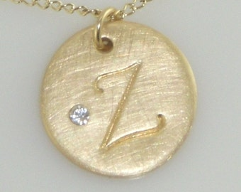 Gold Initial Necklace adorned with a Tiny Embedded Swarovski Crystal