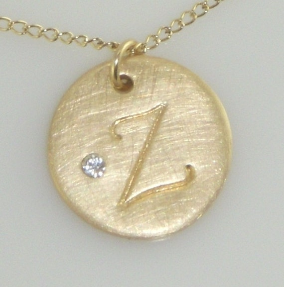 Gold Initial Necklace adorned with a Tiny Emedded Swarovski Crystal