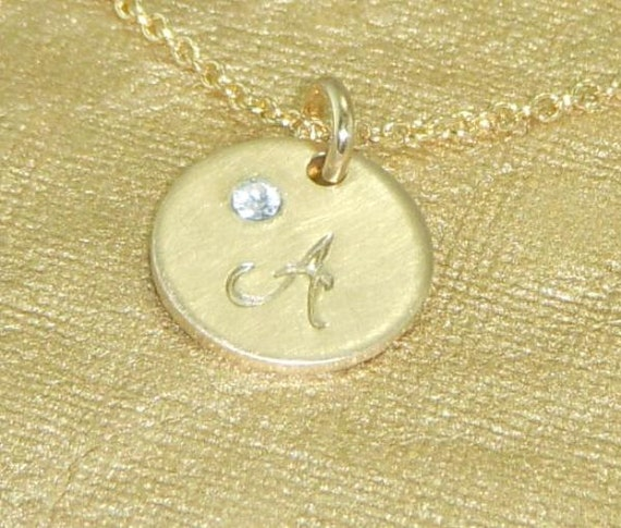 Cursive Monogram Print-Gold Initial Necklace adorned with a Tiny Embedded Swarovski Crystal