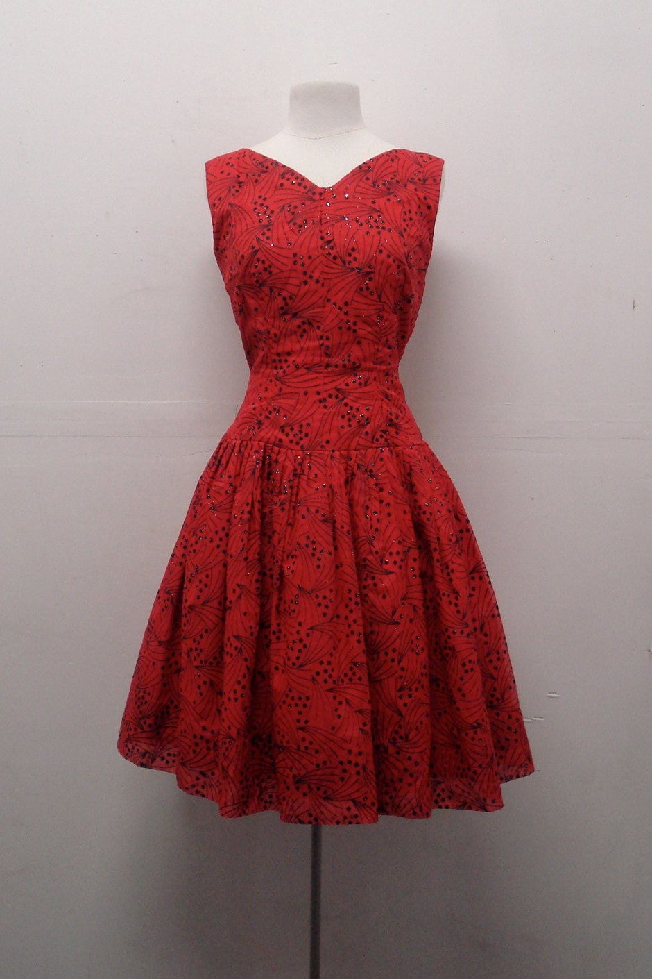 Vintage 1950s red cocktail dress with dropped waist