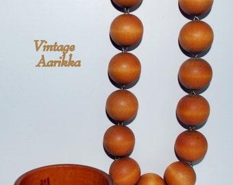 1960s Modernist Aarikka Vintage Orange Wood Bead Necklace by Finnish Designer Kaija Aarikka, Necklace is 32 in. long.
