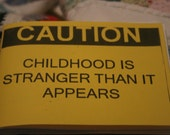 Caution, Childhood Is Stranger Then It Appears