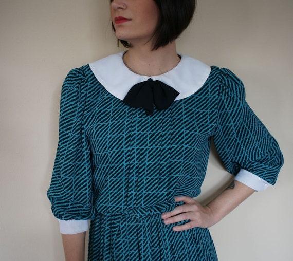 reserved for flashbak- 70s Teal Animal Print Secretary Dress (s-m)