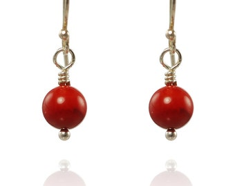 Sterling silver earrings with red coral.
