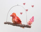 Lovebird Mobile perched for a KISS- fabric sculpture on yarn wrapped branch in tango orange, hot pink, red, coral, and gray