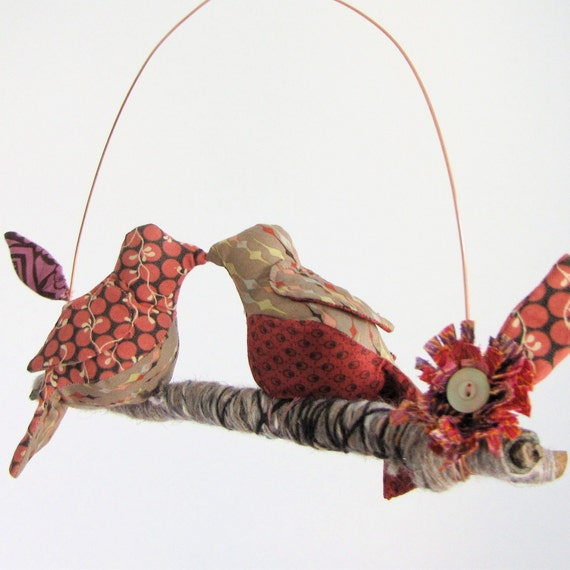 2 little lovebirds sitting in a tree - K-I-S-S-I-N-G - fabric mobile on yarn wrapped branch in rose, red, and tan