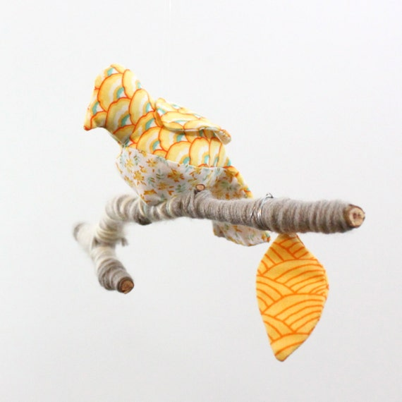 A little bird told me - sculpture on yarn wrapped branch in sunshine yellow, ocean blue, white, and peach
