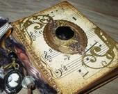 Small Book with Vintage Sheet Music