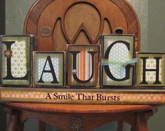 Laugh - A Smile That Bursts Inspirational Sign