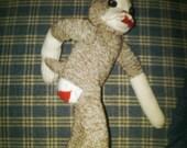 Sock monkey that looks like a Boston terrier