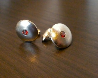 On SALE  Cast sterling silver cufflinks with red garnets.