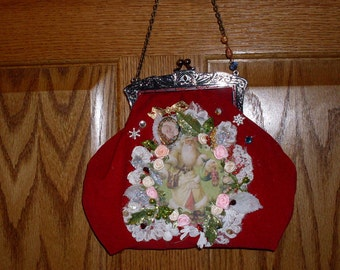 Red velvet purse with Santa image.