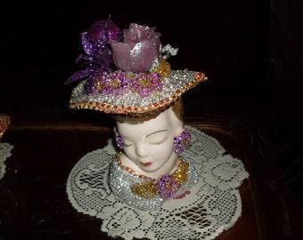 Jeweled lady head vase