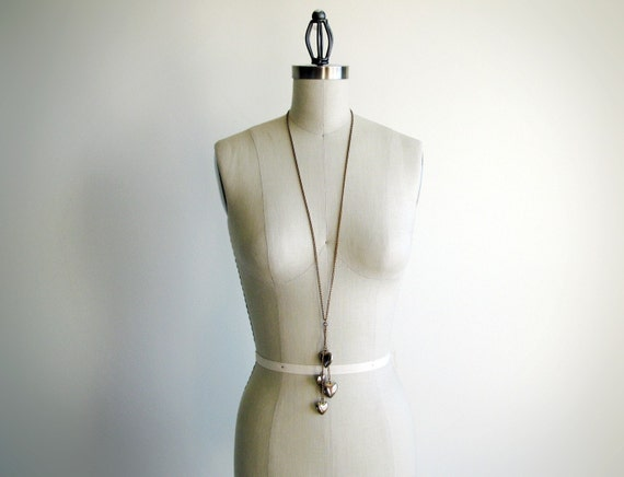 Vintage brass chain heart shaped pendant necklace.