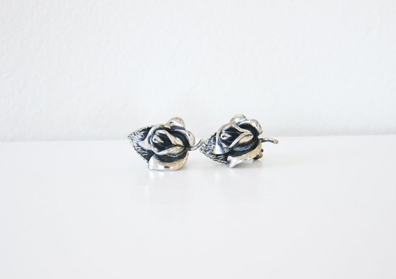 Vintage rose clip earring.