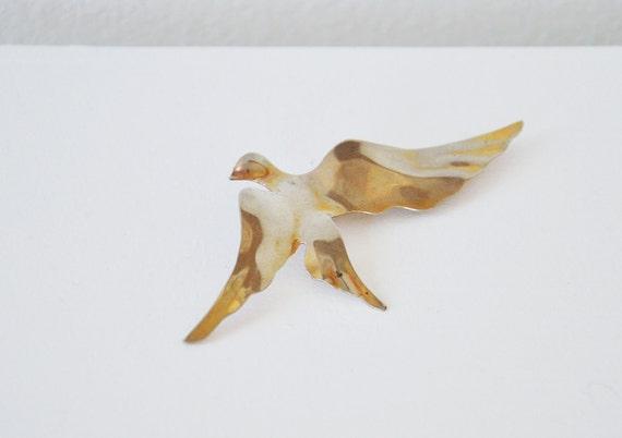 Vintage gold bird brooch.