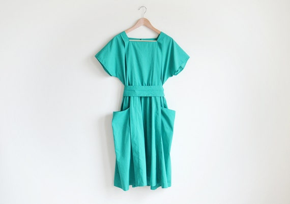 Vintage turquoise tunic dress with a belt.
