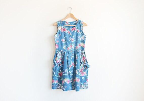 Vintage blue floral dress with ribbon pockets.