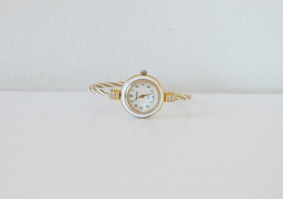 Vintage PIEVA NICOL quartz gold and white wrist watch.