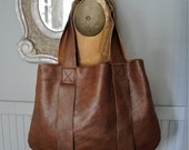 Simple leather unlined bag