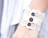 Ivory lace cuff with buttons