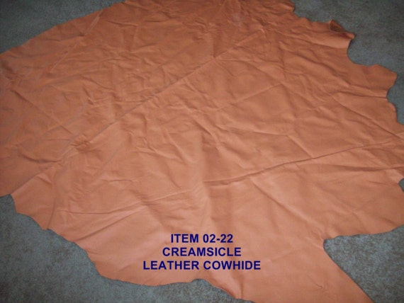 2-22   Leather Cowhide in creamsicle color   Reserved for Debra